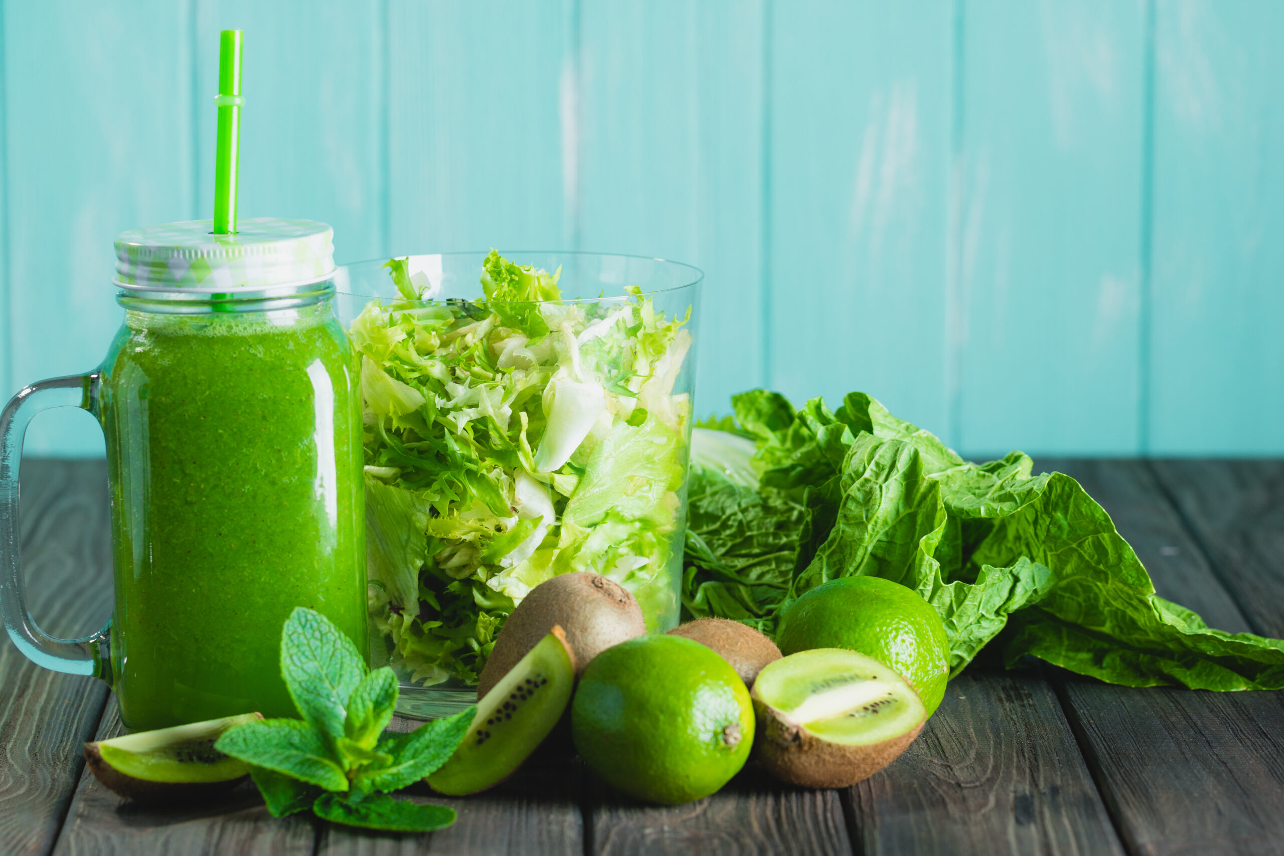 Blended,Green,Smoothie,With,Ingredients,On,Wooden,Table,Selective,Focus.