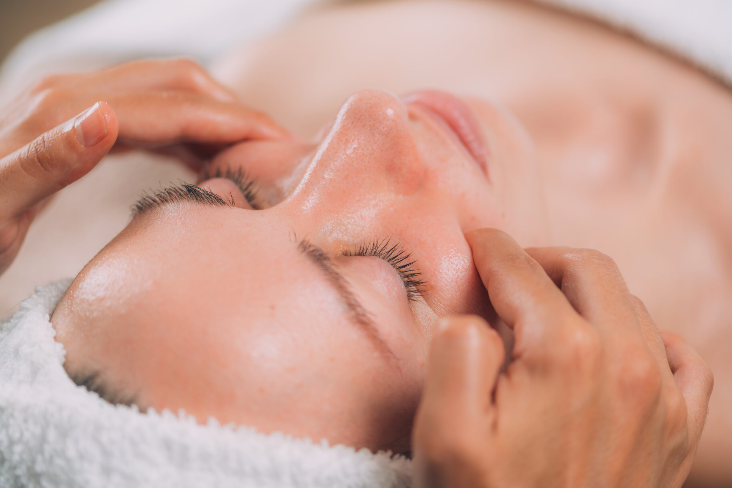 Facial,Massage,Beauty,Treatment.,Close-up,Of,A,Young,Woman's,Face