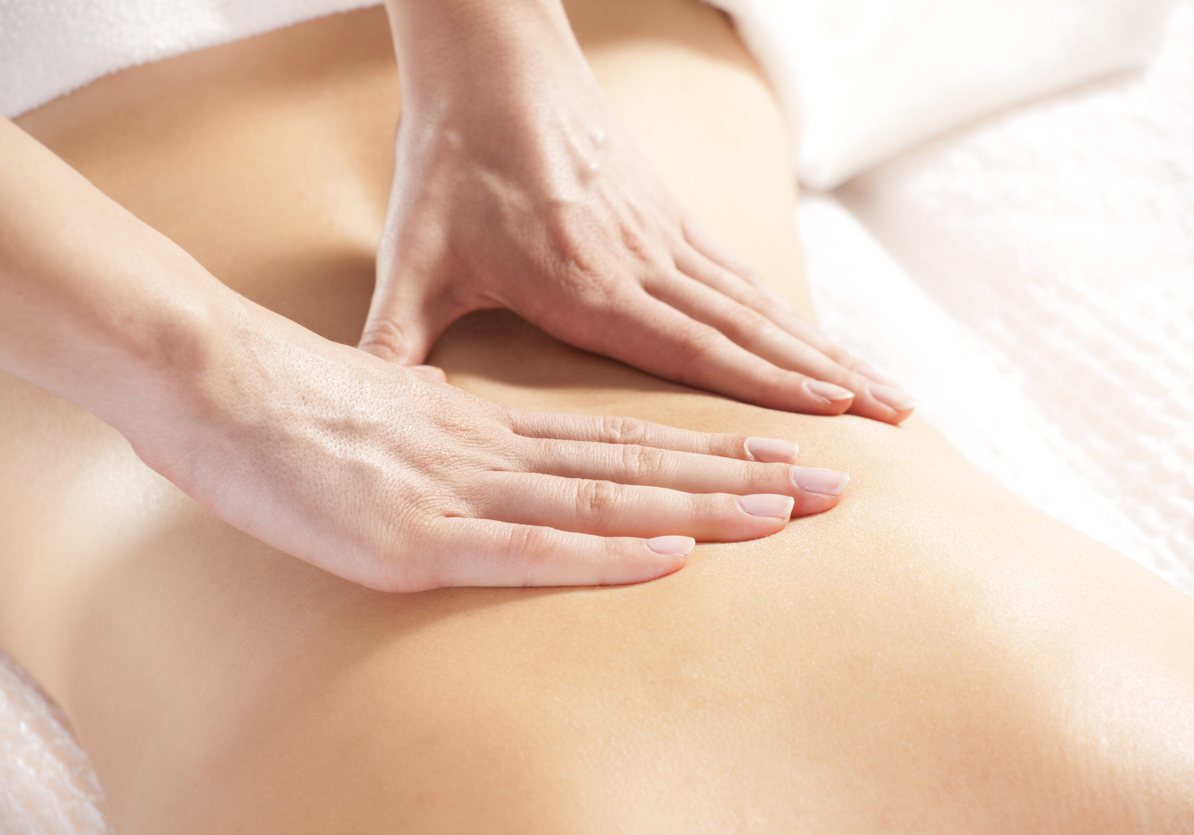Woman,Giving,Back,Massage,To,A,Girl
