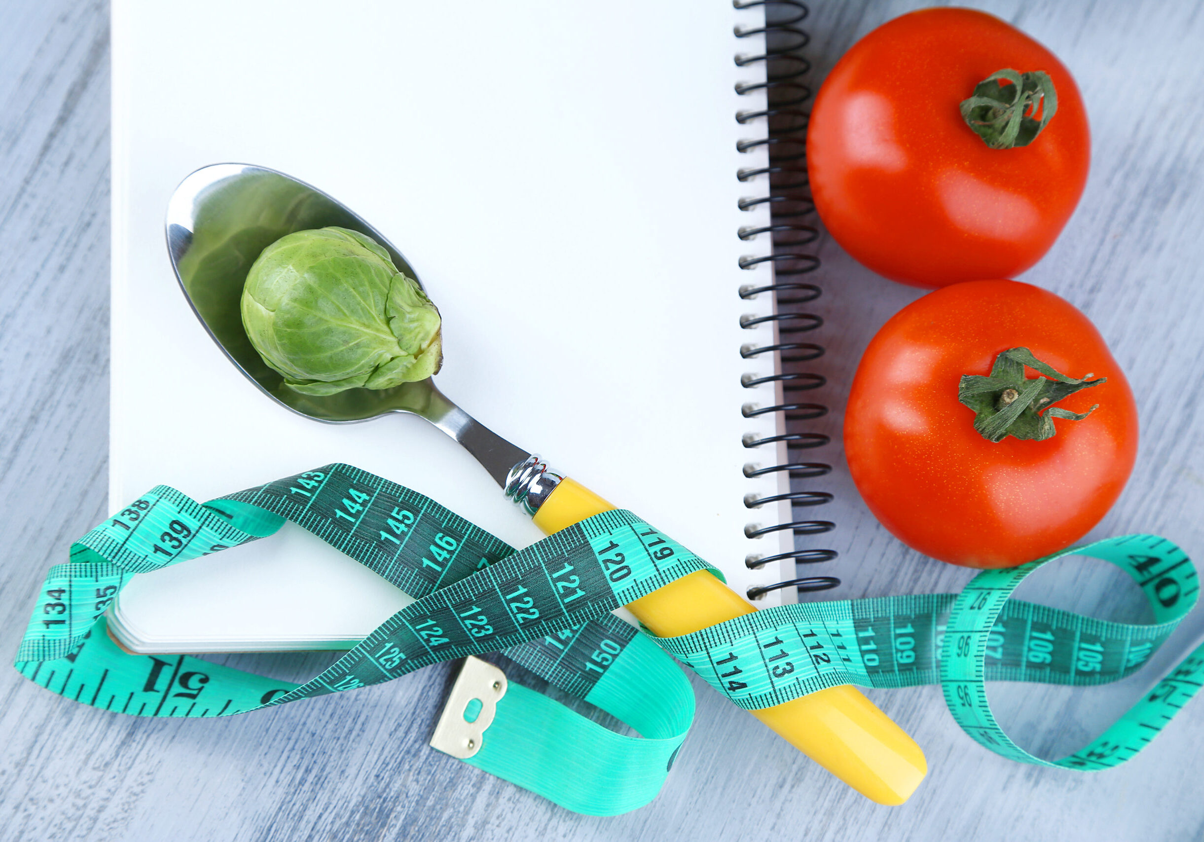 Notebook,With,Measuring,Tape,And,Vegetables,On,Wooden,Background